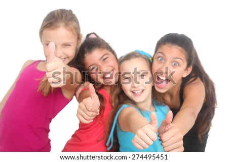 group of four happy kids showing thumbs up