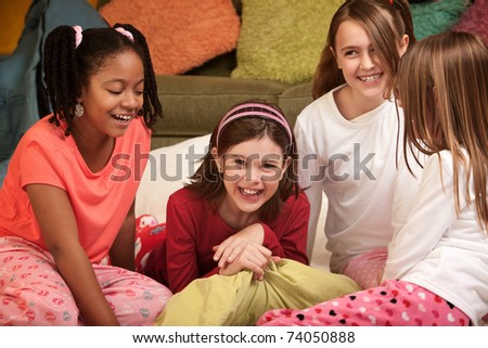 Group of four happy little girls at a sleepover - stock photo