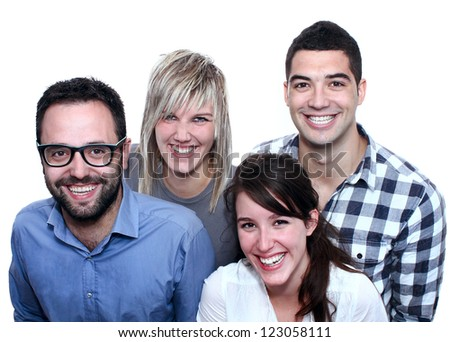 Group of four real, everyday people posing with a big smile - stock photo