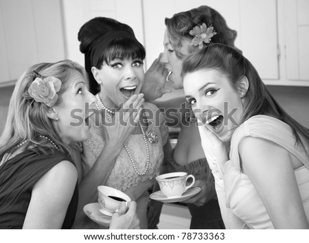 Group of four retro fashion housewives tell secrets in the kitchen - stock photo