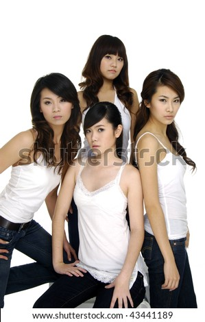 Group of four sexy, beautiful young happy women - stock photo