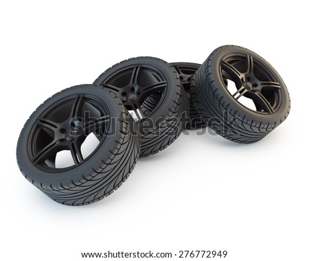 group of four wheels on black rims - stock photo