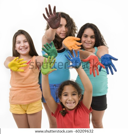group of four young girls with their hands painted isolated on white.
