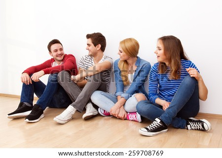 Group of four young people indoors - stock photo