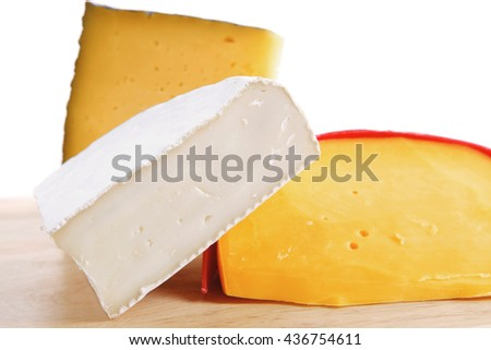 group of french aged delicatessen cheeses on wooden table - stock photo