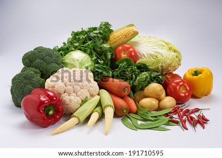 Group of fresh and colorful vegetable with plain background - stock photo