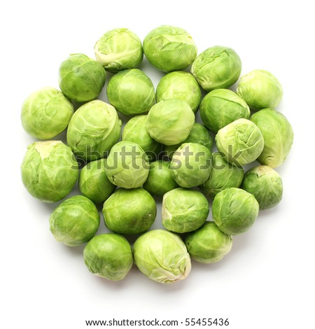 group of fresh brussels sprouts on white - stock photo