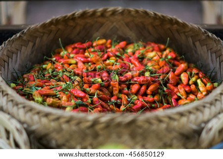 Group of fresh chili on wooden mat basket - stock photo