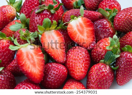 Group of fresh delicious red Strawberries. Strawberries are with green stems and leaves - stock photo