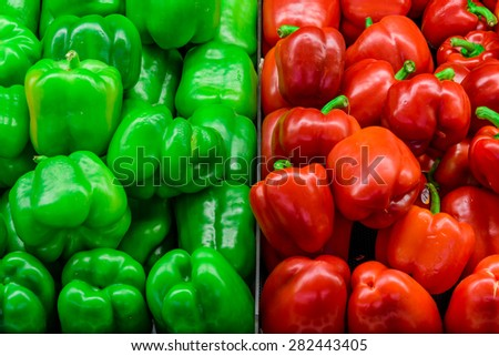 Group of fresh green and red peppers in a supermarket at Colfax, Whitman County, Washington, USA. Close up and full frame view of peppers. Color full and healthy concept.  - stock photo