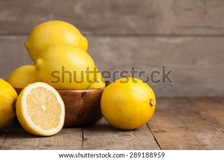 Group of fresh lemon on an old vintage wooden table - stock photo