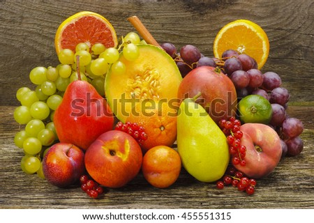 group of fresh mixed fruits from farmers market - stock photo