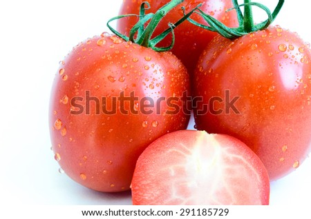 Group of fresh ripe Roma Tomatoes and slice cuts with water drops isolated on white background. Close-up view of Roma tomatoes, also known as Italian tomatoes or Italian plum tomatoes. Copy space. - stock photo