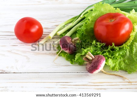 Group of fresh vegetables on the wooden background