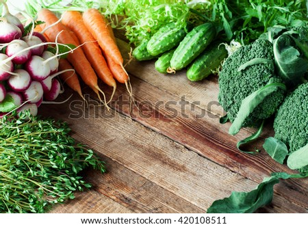 Group of fresh vegetables on wooden background - stock photo