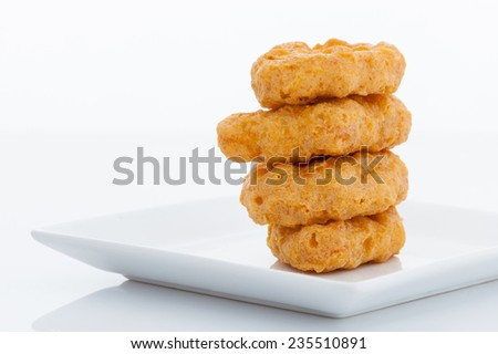 Group of fried chicken nuggets on white dish - stock photo