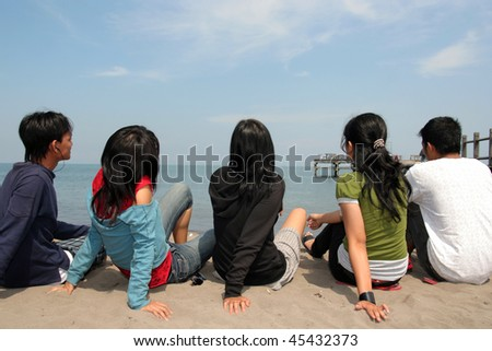group of friend at beach - stock photo