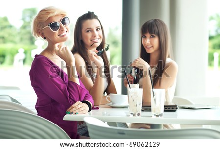 Group of friend enjoying coffee break - stock photo