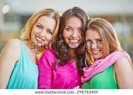 Group of friendly and stylish young women looking at camera - stock photo