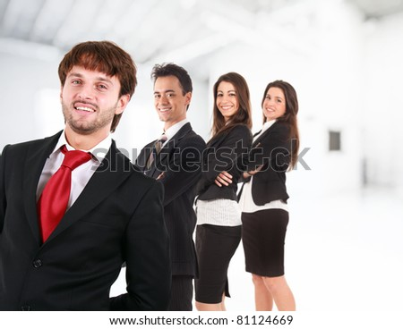 Group of friendly businesspeople in an office environment. - stock photo
