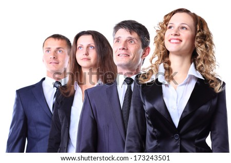 Group of friendly businesspeople with happy female leader in front - stock photo