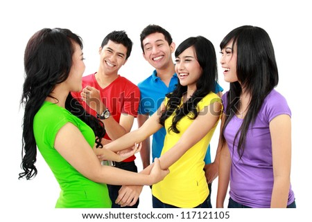 Group of friendly teenagers having fun together - stock photo
