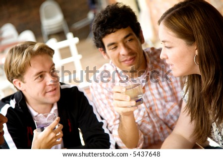 group of friends at a restaurant talking and drinking
