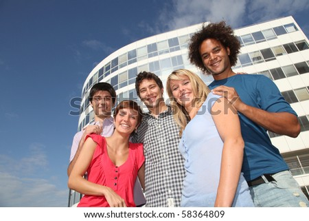 Group of friends at college campus - stock photo