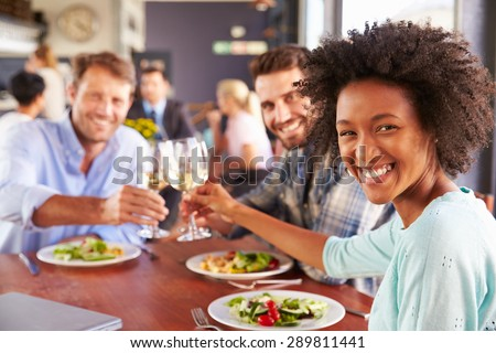 Group of friends at lunch in a restaurant - stock photo