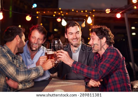 Group of friends at rooftop party - stock photo