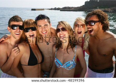Group of friends at the beach - stock photo