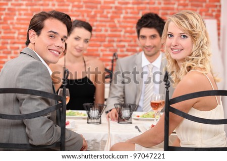 Group of friends at the restaurant - stock photo