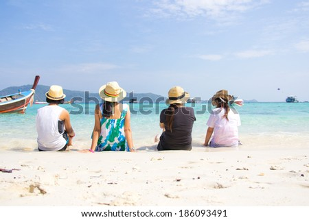 Group Of Friends At The Sand Beach