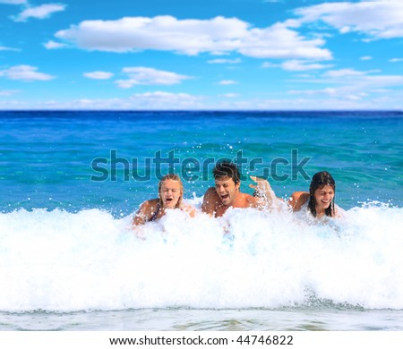 Group of friends at their summer vacation by the sea - stock photo
