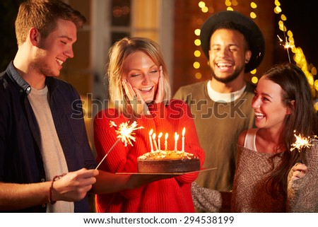 Group Of Friends Celebrating Birthday At Outdoor Party - stock photo