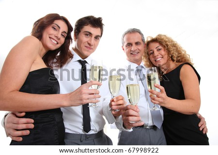Group of friends cheering with glasses of champagne