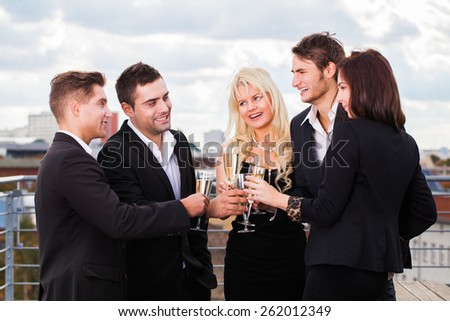 group of friends clinking glasses - stock photo