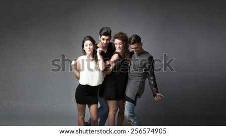 group of friends dancing - stock photo