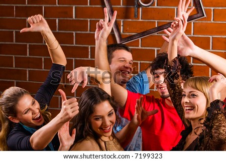 Group of friends dancing at a night club - stock photo