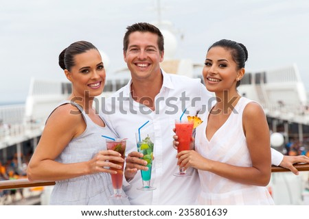 group of friends drinking cocktails on cruise ship - stock photo