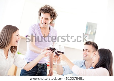 Group of friends drinking red wine.