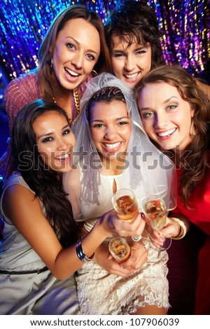 Group of friends drinking to the health and happiness of the bride
