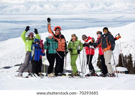 Group of friends, enjoying at mountain ski resort - stock photo