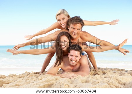 Group Of Friends Enjoying Beach Holiday - stock photo
