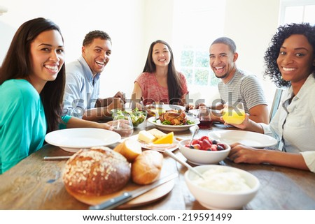 Group Of Friends Enjoying Meal At Home Together - stock photo