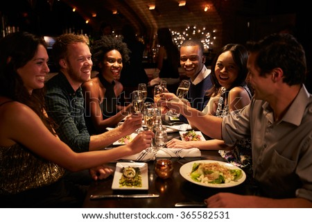 Group Of Friends Enjoying Meal In Restaurant - stock photo