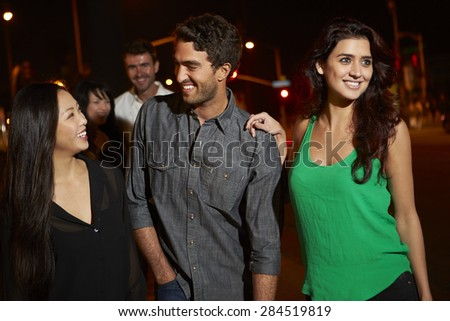 Group Of Friends Enjoying Night Out Together - stock photo