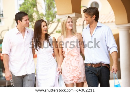 Group Of Friends Enjoying Shopping Trip Together - stock photo