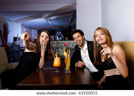Group of friends enjoying show. Focus on women on the left