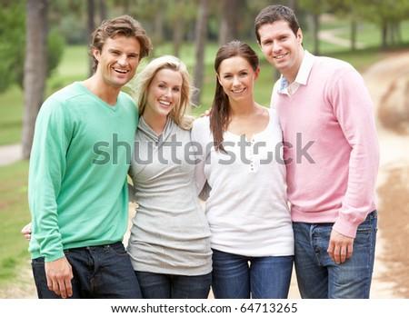 Group of friends enjoying walk in park - stock photo